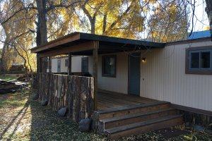 Mobile home with rustic wooden porch