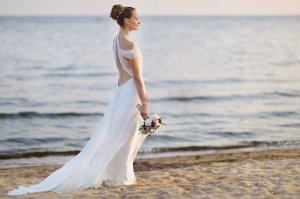 Woman in wedding dress on a beach