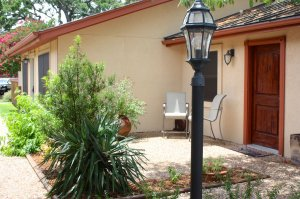 Patio with chairs and lamp post