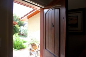 wooden door opening to patio