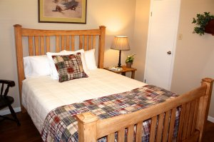 twin bed with rustic quilt