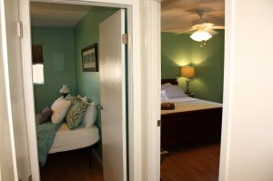 two doorways to two bedrooms