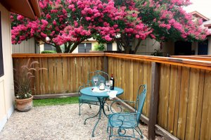 patio table and chairs with wine spread