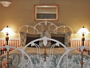 Two White Wrought Iron Beds