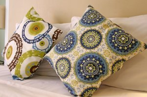 decorative green and blue pillows