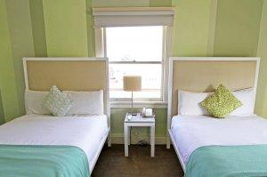 Double beds in green bedroom