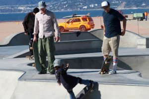men and boy at skate park