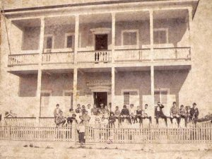 historical photo of front of inn with people lined up