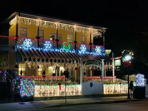 inn lit up at night with thousands of holiday lights