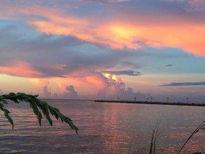 sunset over calm ocean