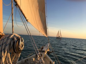 bow of sailing boat with boat on horizon