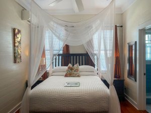 canopy bed with large ceiling fan