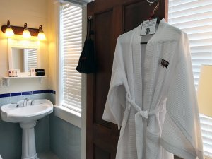 robe hanging on bathroom door