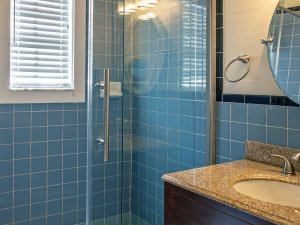 blue tiles in glass shower