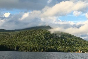 Clouds Over a Forested Mountain