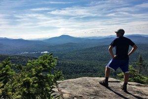 Ethan Standing Atop a Mountain