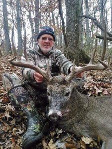 Another hunter and his harvested buck