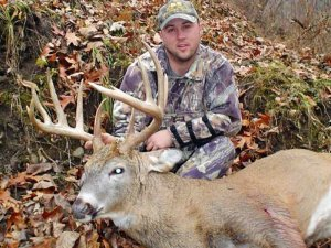Hunter With whit tail Deer