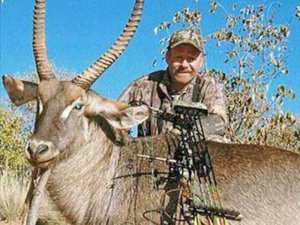 Bow hunter with harvested Waterbuck