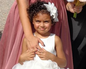 Beautiful Flower Girl in White Dress