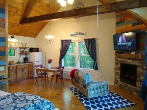 porch swing facing fireplace and TV