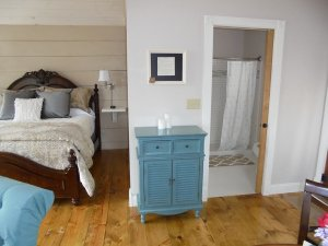wood bed and blue cupboard