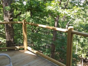 wood balcony above forest