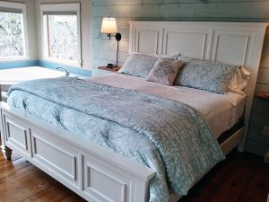 bed with blue spread