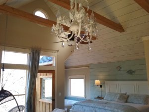vaulted ceilings with chandelier and timbers