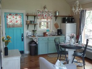 dining and eating area with blue cupboards