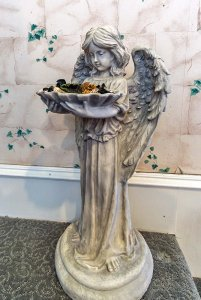 Angel Statue Holding Flowers
