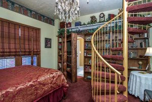 bed near winding staircase