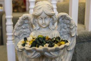 angel statue holding flowers