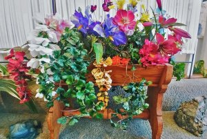 decorative flowers in wooden stand