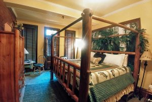 wood four-poster bed