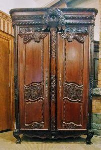 antique armoire with intricate carvings