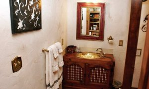 gold bathroom sink and mirror