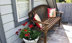Wooden Bench Near Flowers