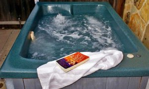 Hot Tub with Towel and Book