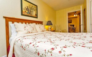 A bed with floral patterns on white covers