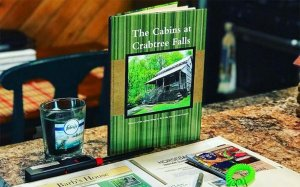 A book and pamphlet featuring the Cabins at Crabtree Falls