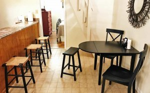 Small table with two chairs and a stool