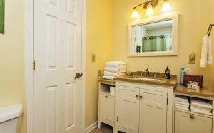 Bathroom sink, mirror, and door
