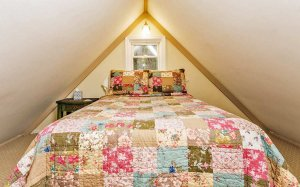 Bed with quilted floral covers