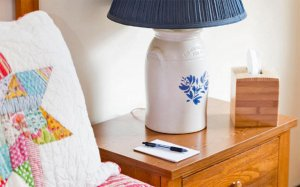 Nightstand with lamp, notepad, and tissue box
