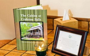 Plaque and book about the Cabins at Crabtree Falls