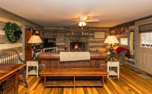 Sitting area with couch and armchair around a coffee table and fireplace