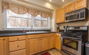Kitchen with sink, stove, and microwave