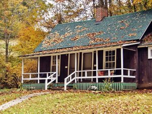 A cottage surrounded by fall colors