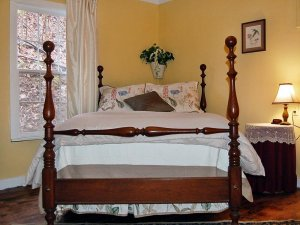A bed with a carved wooden frame